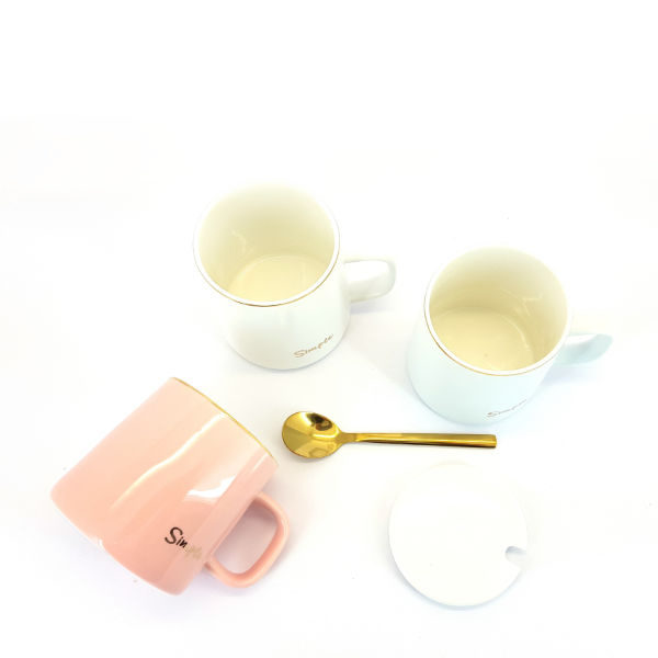 ceramic simple mug with white lid and golden teaspoon